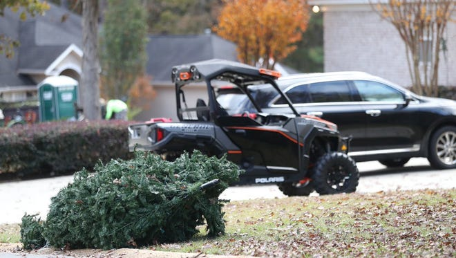 An abandoned, artificial Christmas tree rests on the curb outside Jimbo Fisher's house in Tallahassee on the morning of Dec. 1.