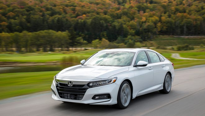 Steady and quiet, the 2018 Honda Accord Touring handles superbly on twisting or straight roads.
