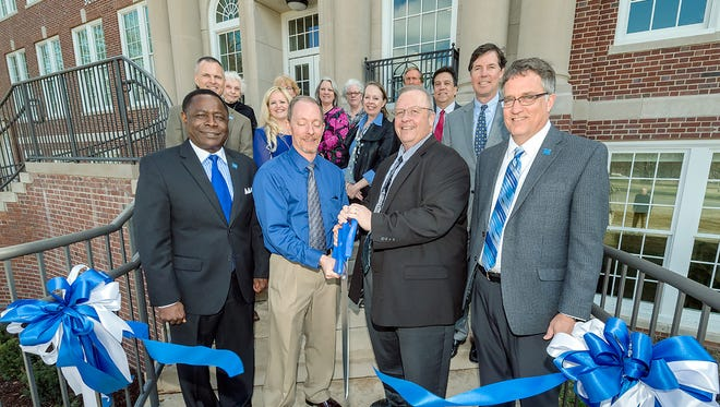 Members of the Strobel family and MTSU staff and administrators watch as university President Sidney A. McPhee, left, physics and astronomy chair Ron Henderson, College of Basic and Applied Sciences Dean Bud Fischer, Turner Construction Co. VP and general manager John Gromos and MTSU interim provost Mark Byrnes perform the ribbon-cutting Feb. 15 on the front steps of Wiser-Patten Science Hall. (MTSU photo by J. Intintoli)