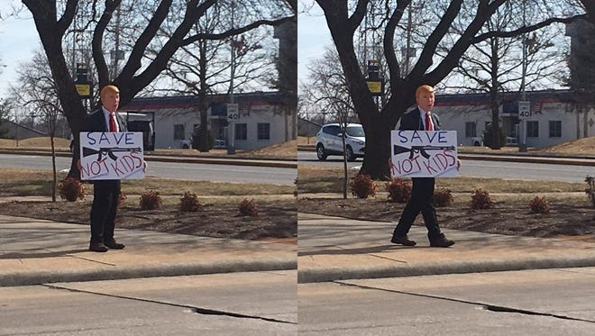 Dr. Gil Mobley stood outside Springfield's Historic City Hall in a Donald Trump costume on Thursday, Feb. 15, 2018.