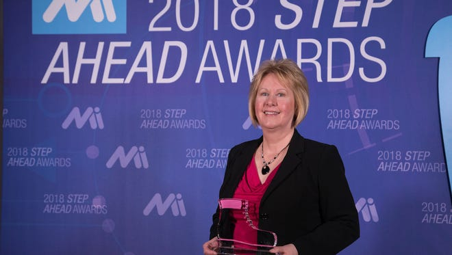 Manitowoc's Lynn Graykowski, manufacturing engineering manager for Welbilt, Inc., collects her Women in Manufacturing STEP Ahead Award April 10 in Washington, D.C.