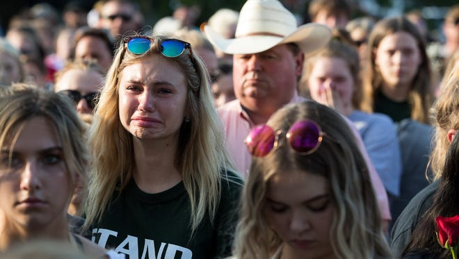 A vigil at Texas First Bank in Santa Fe Texas for the victims of the shooting at Santa Fe High School that left 10 dead Friday, May 18, 2018.