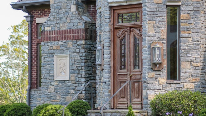The exterior doors of the home at 2060 Hillsboro Road came from castles in the U.K. It's on the market for $6 million.