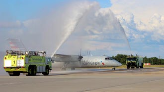 The last Bombardier Dash 8 to be operated under the American regional brand gets a water-cannon salute for the Charlotte-Salisbury flight on July 4, 2018, that would usher it into retirement.