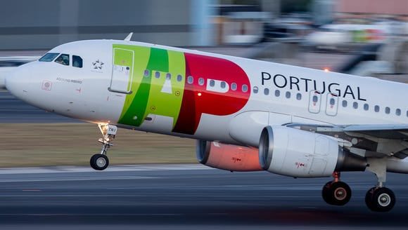 A TAP Portugal Airbus A320 takes off from Lisbon Airport