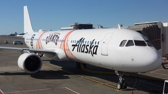 An Alaska Airlines Airbus A321 painted in the colors of the San Francisco Giants baseball team rests at a gate in Seattle-Tacoma International Airport in August 2018.