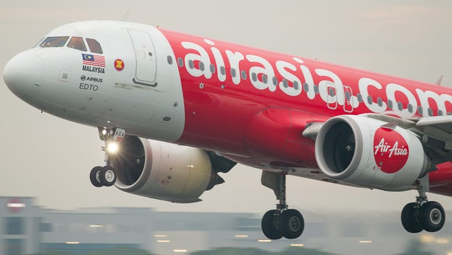 An AirAsia Airbus A320neo lands at Singapore Changi International Airport in October 2018.