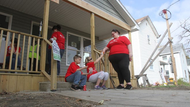 Habitat for Humanity volunteers work on a new home construction project on Mound Street on Saturday, Oct. 25, 2014.