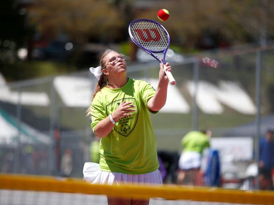 Ashley Harrell competes in a tennis match during Special