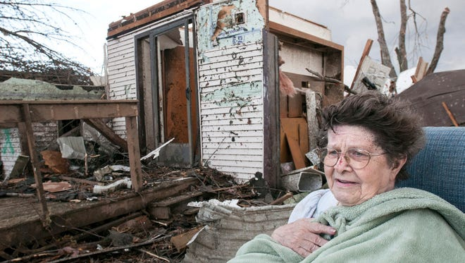 Pat Whitaker, 82, sits under a blanket in her nightgown outside her home waiting for help to come in Gifford, Ill. on Sunday, Nov. 17, 2013. Intense thunderstorms and tornadoes swept across the Midwest, causing extensive damage in several central Illinois communities while sending people to their basements for shelter. (AP Photo/The News-Gazette, Robin Scholz) ORG XMIT: ILCHN101