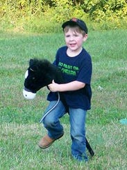 The stick horse race is one event of the Houston County