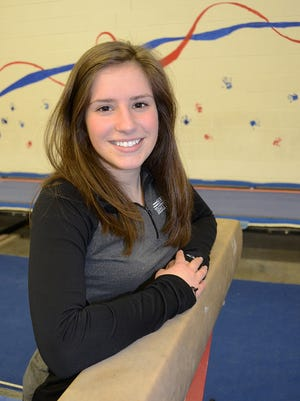 Marjo Mekjian, a junior at Brighton, is the All-County gymnast of the year for the second year in a row.