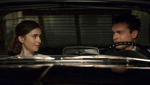 """This image released by Twentieth Century Fox shows Lily Collins, left, and Alden Ehrenreich in a scene from """"Rules Don't Apply."""""""