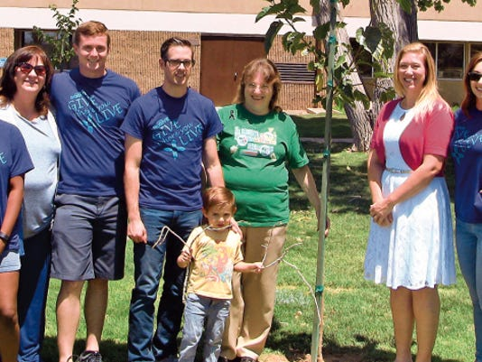 Pictured from left to right are Airman First Class Shakira Woods, City Commissioner and President of Friends of the Library Nadia Sikes, Senior Airman Ryland Doerr, Captain Kyle Astle, Atticus Astle, Library Manager Sharon Rowe, Mayor Susie Galea and Lynette Astle. Not pictured is Refuel team member Daniel Stech.