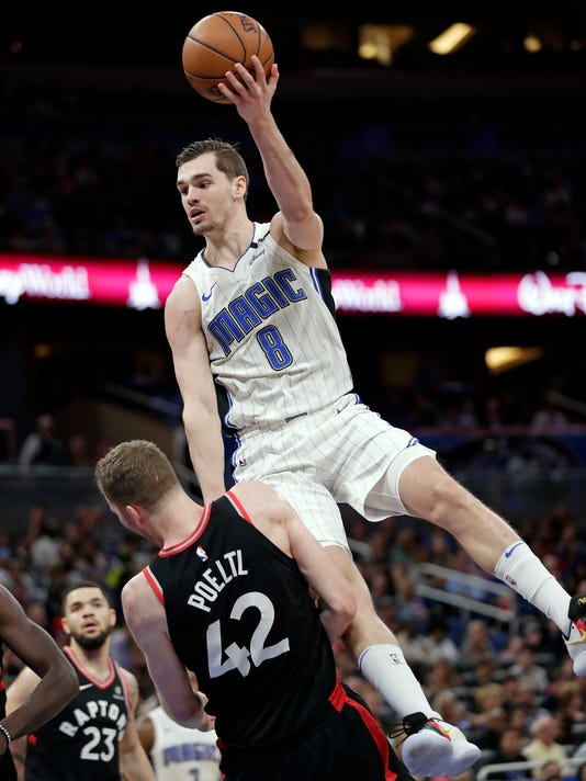 Orlando Magic's Mario Hezonja (8) is called for an offensive foul as he tries to go over Toronto Raptors' Jakob Poeltl (42) for a shot during the second half of an NBA basketball game Wednesday, Feb. 28, 2018, in Orlando, Fla. Toronto won 117-104. (AP Photo/John Raoux)