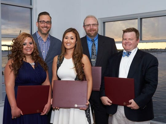 Recent graduates of the Family Medicine Residency Program based at Lee Memorial Hospital are (front row) Sherry Farag, MD; Lucia Huffman, MD;  Jack Arnold, MD and  (back row) James Toldi, DO; Roy Klossner, MD.