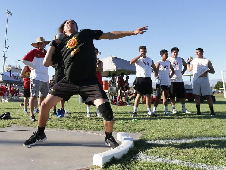 A Palm Desert shot putter lets loose a throw in a meet against La Quinta Thursday