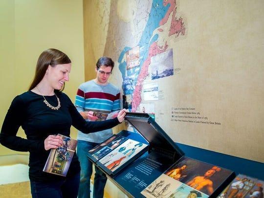 Visitors enjoy informative flip boards at the Museum