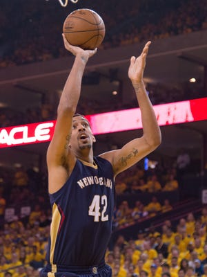 New Orleans Pelicans center Alexis Ajinca (42) shoots the basketball during the first quarter in game one of the first round of the NBA Playoffs against the Golden State Warriors at Oracle Arena. The Warriors defeated the Pelicans 106-99.