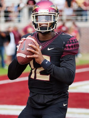 Nov 21, 2015; Tallahassee, FL, USA; Florida State Seminoles quarterback Deondre Fracois (12) warms up before the game against the Chattanooga Mocs at Doak Campbell Stadium. Mandatory Credit: Glenn Beil-USA TODAY Sports