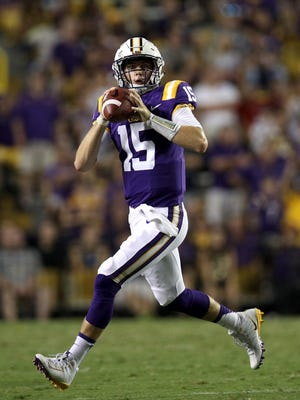 Myles Brennan of the LSU Tigers throws a pass against the Troy Trojans at Tiger Stadium on September 30, 2017 in Baton Rouge.