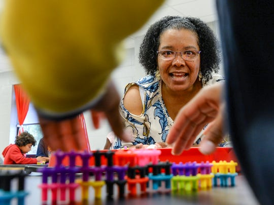 Michelle Traynum, STEAM coach at Homeland Park Elementary in Anderson, watches children from Candice Kyle's second grade class build a wall with blocks on Wednesday. The engineering task included building with two different types of blocks, and learning one held up better than the other.