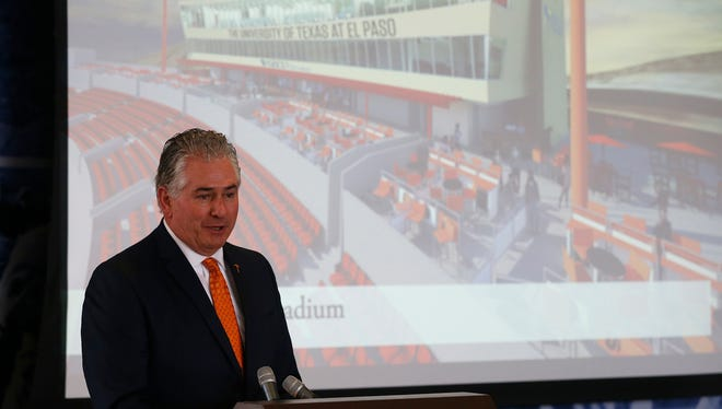 UTEP athletic director Jim Senter shows one of the slides depicting the planned renovations to Sun Bowl Stadium. Senter, along with UTEP President Diana Natalicio and GECU President and CEO Crystal Long, unveiled the future look of the stadium during a news conference Friday in the Larry K. Durham Sports Center. The improvements will bring a renovated press area, a drop-off area, a new sky lounge and loge boxes seating area.