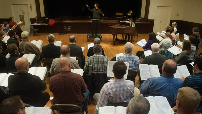 Symphony In C Music Director Stilian Kirov leads members of the Greater South Jersey Chorus as they rehearse, at the Haddonfield Center and School for the Performing Arts at Grace Church, for their upcoming performance of The Messiah with Symphony in C. 11.28.16