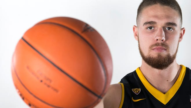 ASU center Eric Jacobsen poses for a portrait during ASU Basketball Media Day at the Weatherup Practice Facility in Tempe on Thursday, October 2, 2014.