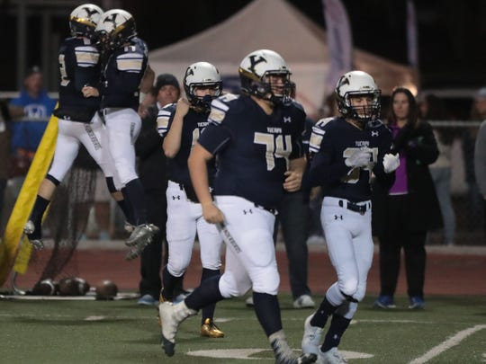 Yucaipa celebrate their 3rd touchdown against La Quinta on Friday, November 10, 2017 in Yucaipa.