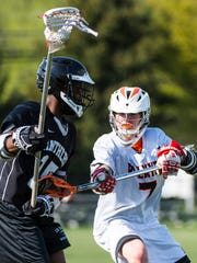 Palmyra's Kyle Nolen battles Central Dauphin East's DQ Reid as Palmyra ran over Central Dauphin East 19-0 on Tuesday, April 18, 2017.