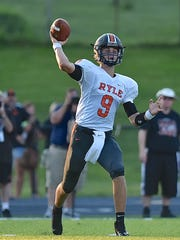 Ryle's Jake Smith drops back to pass against Covington