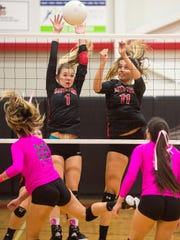 South Fork's Aubrie Hataway (left) and Caitlyn Leadabrand