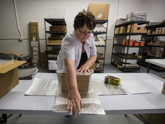 Barbara Dolleschal, manager of Zotter Chocolates, prepares an online order for shipping Wednesday, August 9, at the retail location on Pine Island Road in Cape Coral.