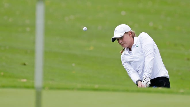 Green Bay Notre Dame senior Emily Smits chips onto the ninth green during the WIAA Division 1 girls golf regional at Seymour on Wednesday.
