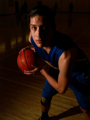 Bloomfield's Brendon Charley poses for a portrait on Monday at the North Gym at Bloomfield High School.