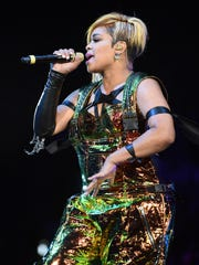 """Tionne """"T-Boz"""" Watkins of TLC performs during the kickoff"""