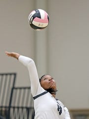 Ankeny Centennial sophomore middle hitter Devyn Robinson (11) serves as the Sioux City East Black Raiders battles against the Ankeny Centennial Jaguars during the Class 5A regional final volleyball match at Ankeny Centennial High School, 2220 NW State St, in Ankeny.