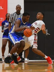 Woodward forward Terry Durham drives to the basket