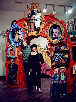 Red Grooms and his wife Mimi stand under the historical