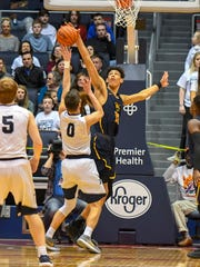 Jaxson Hayes of Moeller (15) blocks the shot of Fairmont's Ryan Hall (0) in the OHSAA District Final, UD Arena, Saturday March 10, 2018