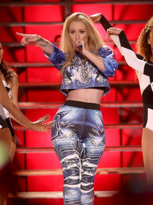 """Iggy Azalea performs at the Vevo Certified SuperFanFest Live Concert at the Barker Hangar, in Santa Monica, California on Oct. 8, 2014. Dick Clark productions announced Monday, Oct. 13, 2014, that Australian rapper Azalea is the lead nominee at the American Music Awards, up for six awards at the Nov. 23, event at Nokia Theatre L.A. Live. Azalea's nominations include artist, new artist and single of the year for her No. 1 smash """"Fancy."""""""