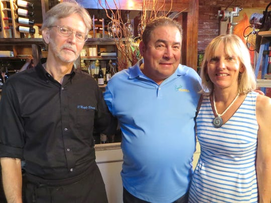 Celebrity Chef Emeril Lagasse poses with Mike and Margie