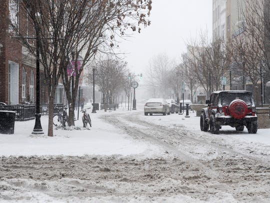 A view of Downtown Main Street during the snowfall Friday afternoon.