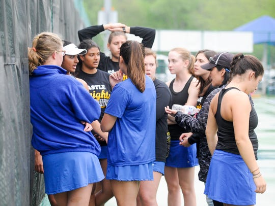 The Castle girls tennis team wait to hear a decision