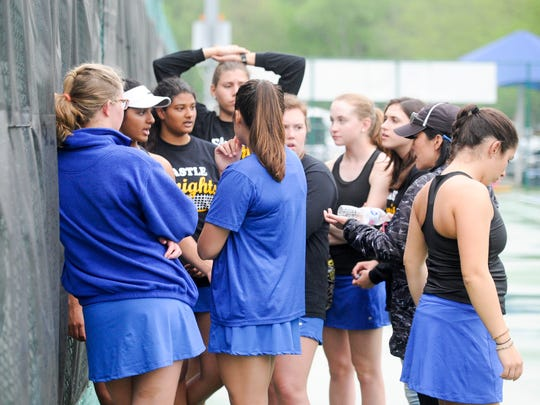 The Castle girls tennis team wait to hear a decision on if they will continue to play after a rain delay during the SIAC girls tennis tournament at Wesselman Park on Friday, May 4.