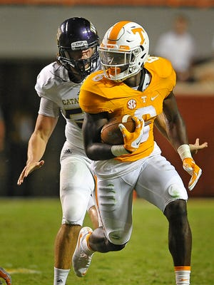 Tennessee running back Alvin Kamara (6) breaks through the line as Tennessee plays Western Carolina on  Sept. 19, 2015.