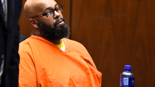 "Marion ""Suge"" Knight closes his eyes as he appears in court for a bail review hearing in his murder case in Los Angeles on Friday, March 20, 2015. Prosecutors are asking a judge to set bail in a murder case against the former rap music mogul Knight at $25 million citing his violent history. The motion filed by Deputy District Attorney Cynthia Barnes on Thursday, March 19, 2015, cites 31 incidents in which Knight is accused of threatening others or using violence. (AP Photo/Robyn Beck, Pool)"