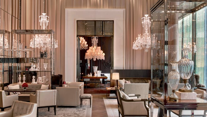 This undated photo provided by Baccarat Hotel & Residences New York shows the grand salon at the Baccarat Hotel & Residences in New York. The Baccarat brand is famous for its crystal but illumination is one of the principle design concepts at the hotel.