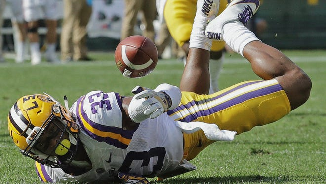 LSU's Jamal Adams can't intercept a pass during the first half of an NCAA college football game against Wisconsin Saturday, Sept. 3, 2016, in Green Bay, Wis. (AP Photo/Morry Gash)